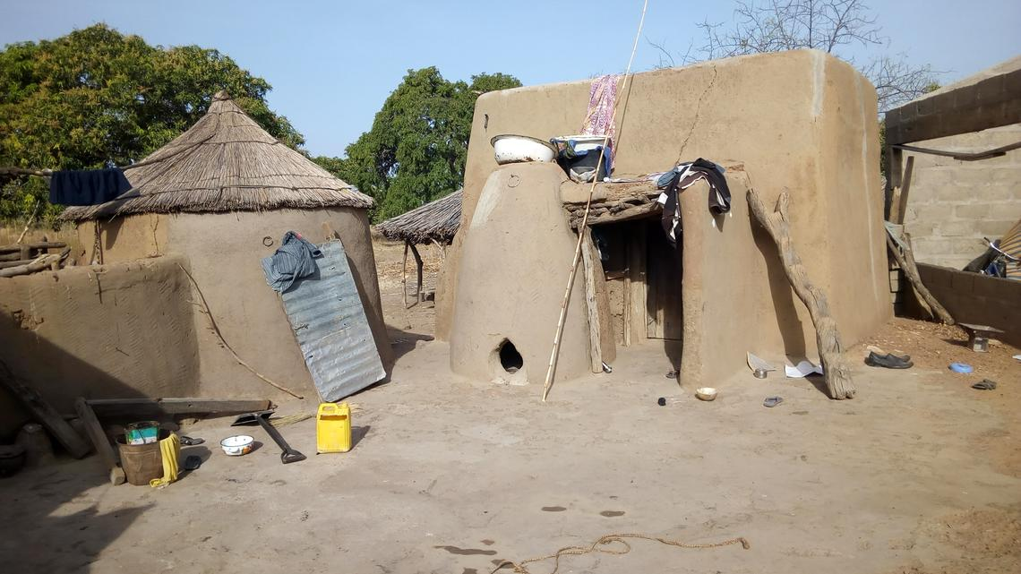Mud huts in the farming village of Balansa, in Ghana, like the ones David Achuroa grew up in.