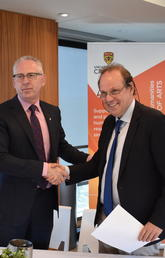 Ed McCauley, vice-president (research) at the University of Calgary, left, shakes hands with Jürgen Renn, director of the Max Planck Institute for the History of Science, on the occasion of a new research partnership between the two institutions.