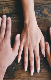 Multiracial human hands on background