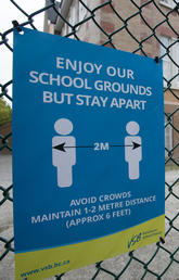 A physical distancing sign is seen at Hastings Elementary school in Vancouver, Sept. 2, 2020.