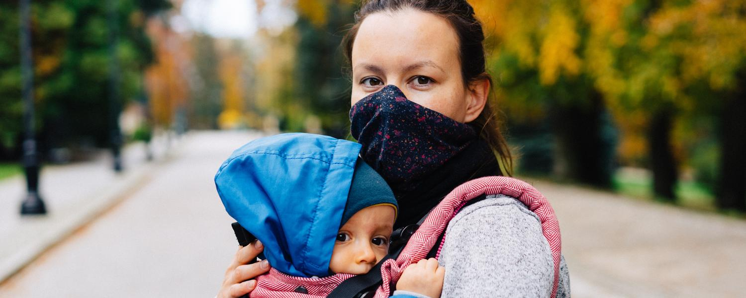Photo of mother wearing face mask and baby by Marcin Jozwiak on Unsplash