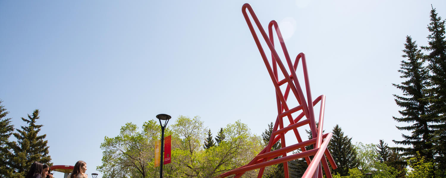 A red sculpture on the campus lawn