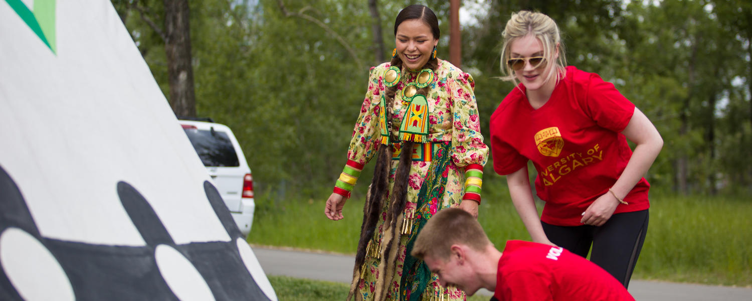 The University of Calgary and the Calgary Stampede hosts Campfire Chats in recognition of National Aboriginal Day. Blackfoot Elder Reg Crowshoe leads guests in tipi-raising and tipi-painting demonstration.