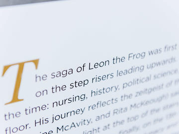 A photo of the Leon the Frog page from The Age of Audacity, a book marking UCalgary's 50th anniversary