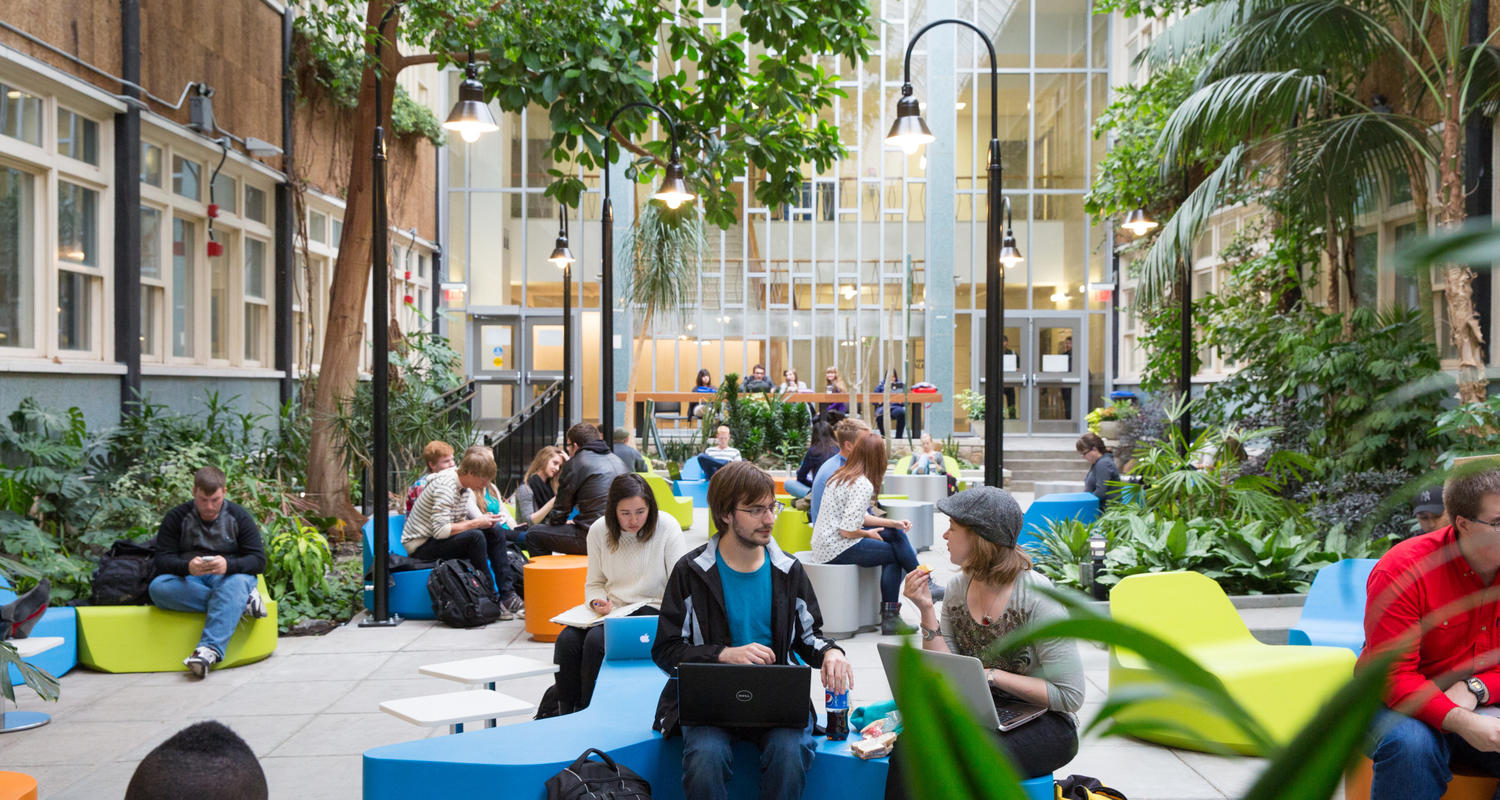 Students studying in the atrium