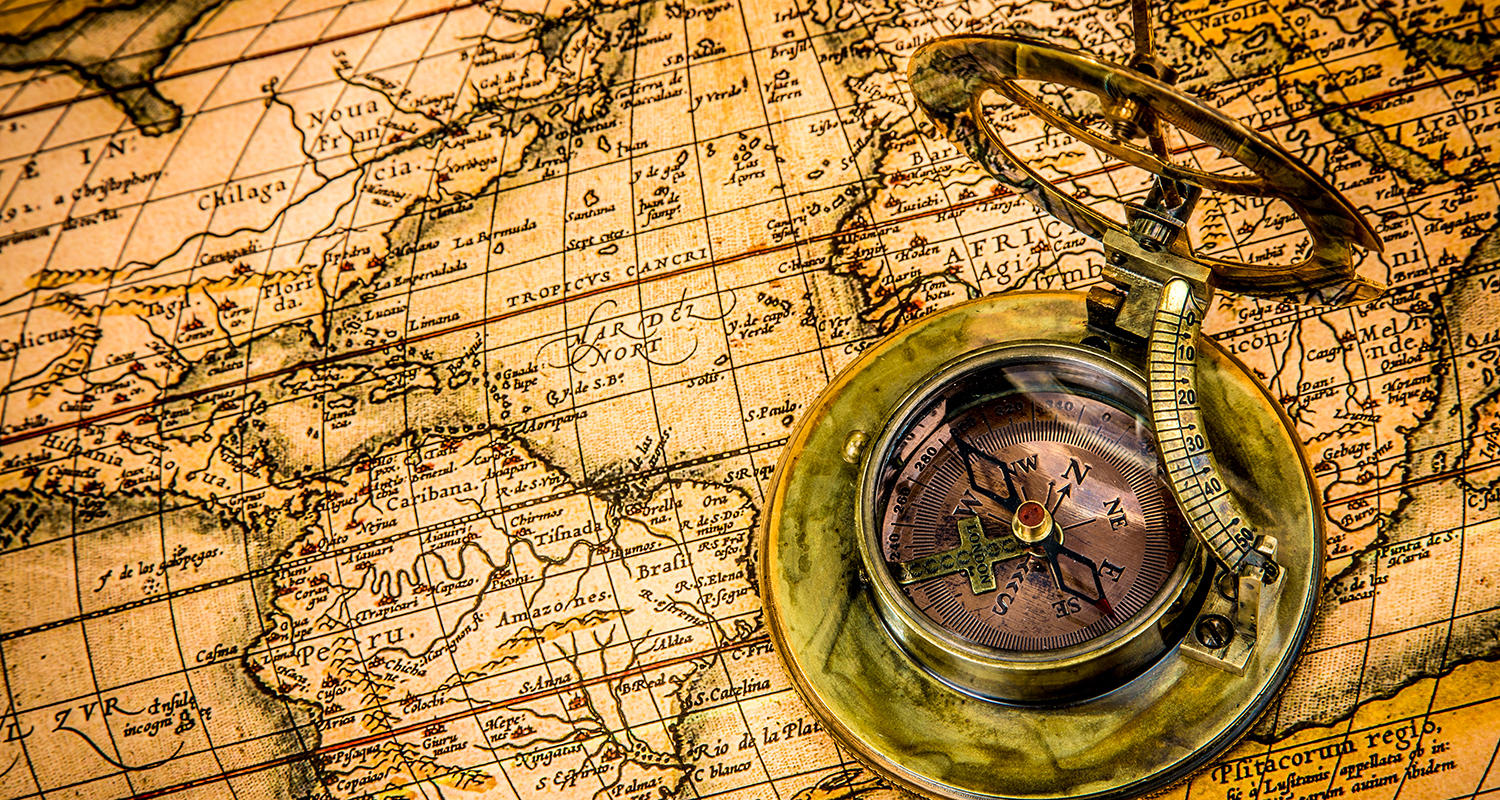 Stock image: A compass on top of a map