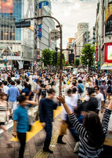 An exhubrant girl enjoys the famous busy crossing in the Japanese capital, Stock image