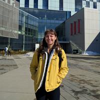 French studies student Bailey Diakow stands in front of the TFDL library