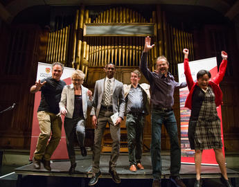 Past wrtiers-in-residence leap on stage together