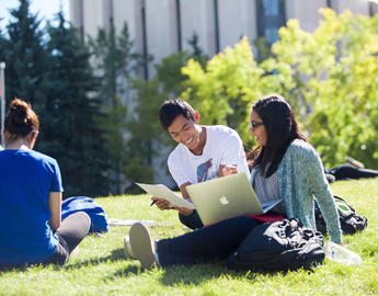 UCalgary students on the grass
